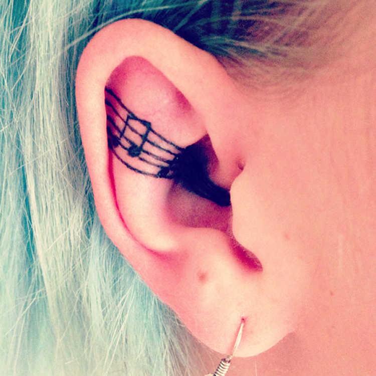 tatuaje oreja musica