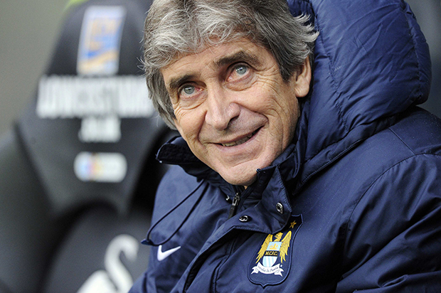 Manchester City's manager Manuel Pellegrini reacts during their English Premier League soccer match against Swansea City at the Liberty Stadium in Swansea