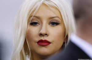 Christina Aguilera prepares to sing the National Anthem before the NFL's Super Bowl XLV football game in Arlington