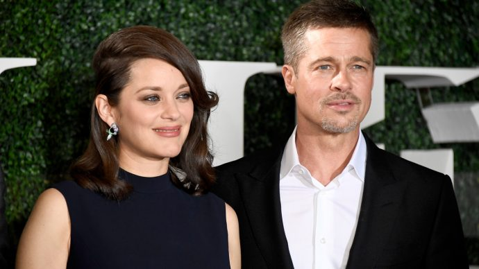"""WESTWOOD, CA - NOVEMBER 09: Actress Marion Cotillard (L) and actor Brad Pitt attend the fan event for Paramount Pictures' """"Allied"""" at Regency Village Theatre on November 9, 2016 in Westwood, California. (Photo by Frazer Harrison/Getty Images)"""