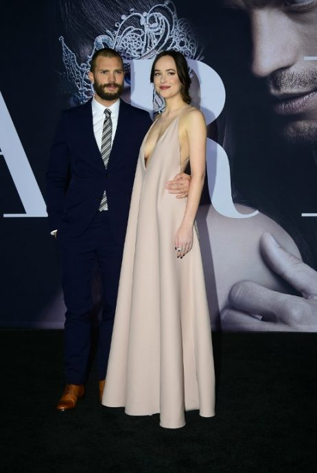"From the cast, actor Jamie Dorner and actress Dakota Johnson pose on arrival for the premiere of the film ""Fifty Shades Darker"" in Los Angeles, California on February 2, 2017. / AFP PHOTO / Frederic J. Brown"